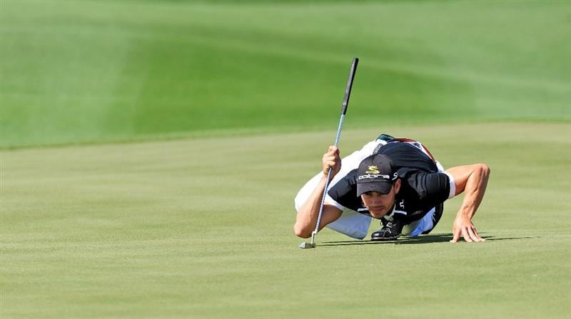 MARANA, AZ - FEBRUARY 18:  Camilo Villegas of Coumbia lines up his putt on the 13th hole during round two of the Accenture Match Play Championship at the Ritz-Carlton Golf Club on February 18, 2010 in Marana, Arizona.  (Photo by Stuart Franklin/Getty Images)