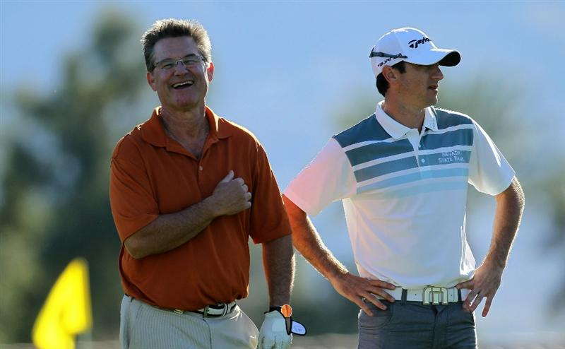 LA QUINTA, CA - JANUARY 20:  Peter Tomasulo (R) jokes with actor Kurt Russell on the 12th tee during round two of the Bob Hope Classic at the La Quinta Country Club on January 20, 2011 in La Quinta, California.  (Photo by Stephen Dunn/Getty Images)