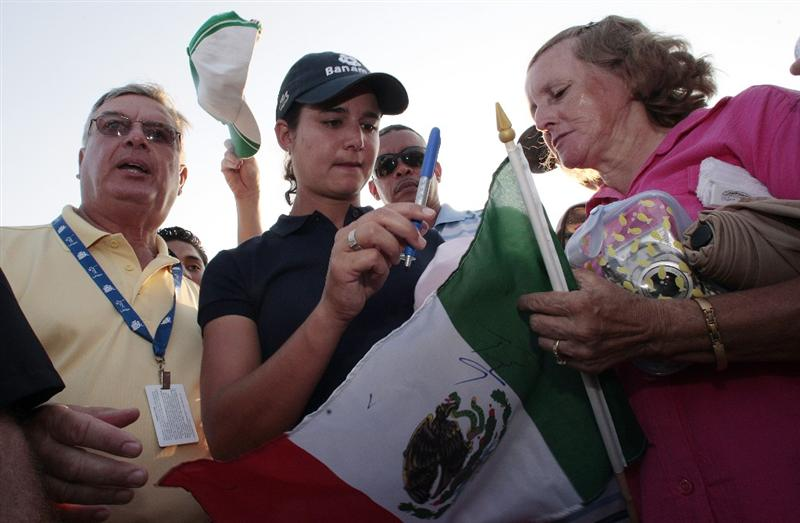 PRATTVILLE, AL - SEPTEMBER 28:   Lorena Ochoa of Mexico signs a Mexican flag for Teresa Santiel of Vera Cruz, Mexico after winning the Navistar LPGA Classic at the Robert Trent Jones Golf Trail at Capitol Hill on September 28, 2008 in Prattville, Alabama.  Ochoa beat Cristie Kerr and Candie Kung in a playoff. (Photo by Dave Martin/Getty Images)