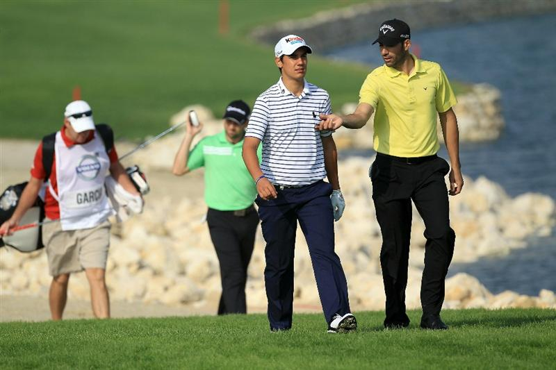 BAHRAIN, BAHRAIN - JANUARY 27:  Alvaro Quiros of Spain walking to the green with Matteo Manassero of Italy at the 16th hole during the first round of the 2011 Volvo Champions held at the Royal Golf Club on January 27, 2011 in Bahrain, Bahrain.  (Photo by David Cannon/Getty Images)
