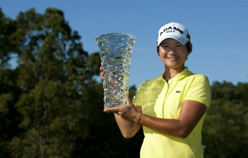 ROGERS, AR - SEPTEMBER 12:  Yani Tseng of Taiwan holds the winner's trophy after winning the P&G NW Arkansas Championship at the Pinnacle Country Club on September 12, 2010 in Rogers, Arkansas.  (Photo by Robert Laberge/Getty Images)