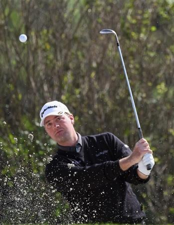 SHANGHAI, CHINA - NOVEMBER 10:  Peter Hanson of Sweden chips out of the bunker on the par three 17th hole during the final round of the HSBC Champions at Sheshan Golf Club on November 10, 2008 in Shanghai, China.  (Photo by Ross Kinnaird/Getty Images)