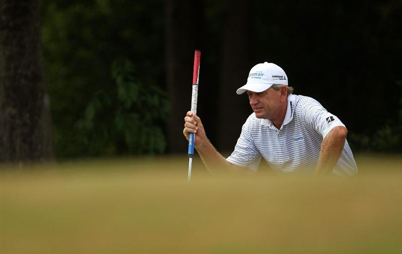 LUTZ, FL - APRIL 16:  Nick Price lines up a putt on the  10th hole during the second round of the Outback Steakhouse Pro-Am at the TPC of Tampa on April 16, 2011 in Lutz, Florida.  (Photo by Mike Ehrmann/Getty Images)