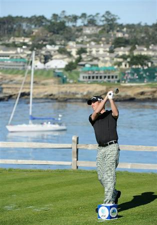 PEBBLE BEACH, CA - FEBRUARY 11:  Aaron Baddeley of Australia plays his tee shot on the seventh hole during the second round of the AT&T Pebble Beach National Pro-Am at the Pebble Beach Golf Links on February 11, 2011  in Pebble Beach, California  (Photo by Stuart Franklin/Getty Images)