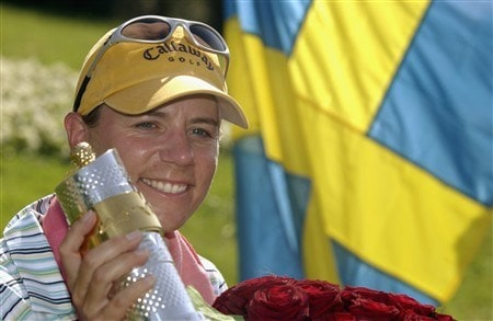 EVIAN, FRANCE - JUNE 15:  Annika Sorenstam of Sweden poses with the trophy after winning the Evian Masters on June 15, 2002 at the Evian Masters Golf Club in Evian-les-Bains, France.  (Photo By Stuart Franklin /Getty Images)