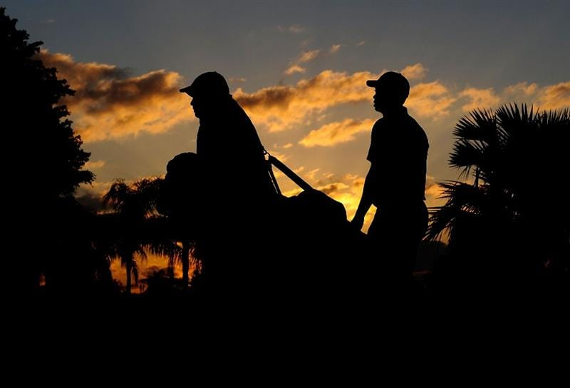 DORAL, FL - MARCH 11:  Tiger Woods and caddie Steve Williams walk down the 3rd hole during the final day of practice for the World Golf Championships-CA Championship at the Doral Golf Resort & Spa on March 11, 2009 in Miami, Florida.  (Photo by Sam Greenwood/Getty Images)