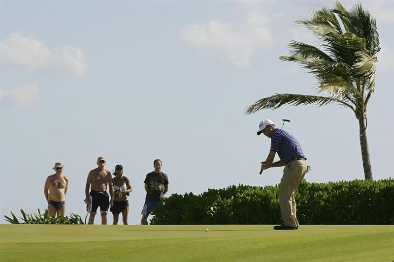 PLAYA DEL CARMEN, MEXICO - FEBRUARY 24:  Charles Warren reacts to a missed putt on the 15th green as spectators in beach attire look on during the first round of the Mayakoba Golf Classic at Riviera Maya-Cancun held at El Camaleon Golf Club on February 24, 2011 in Playa del Carmen, Mexico.  (Photo by Michael Cohen/Getty Images)