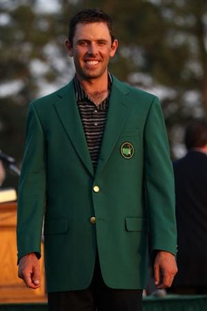 AUGUSTA, GA - APRIL 10:  Charl Schwartzel of South Africa smiles to the gallery at the green jacket presentation after his two-stroke victory at the 2011 Masters Tournament at Augusta National Golf Club on April 10, 2011 in Augusta, Georgia.  (Photo by Andrew Redington/Getty Images)