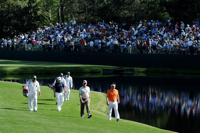 AUGUSTA, GA - APRIL 07:  Zach Johnson, Miguel Angel Jimenez of Spain and Y.E. Yang of Korea walk to the 16th green with their caddies during the first round of the 2011 Masters Tournament at Augusta National Golf Club on April 7, 2011 in Augusta, Georgia.  (Photo by Harry How/Getty Images)