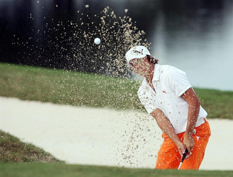 WEST PALM BEACH, FL - DECEMBER 07:  Rickie Fowler chips out of the greenside bunker on the 18th hole during the final round of the 2009 PGA TOUR Qualifying Tournament at Bear Lakes Country Club on December 7, 2009 in West Palm Beach, Florida.  (Photo by Doug Benc/Getty Images)