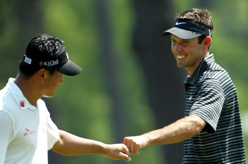 AUGUSTA, GA - APRIL 10:  Charl Schwartzel of South Africa (R) celebrates with K.J. Choi of South Korea after Schwartzel holed a shot for eagle on the third green during the final round of the 2011 Masters Tournament on April 10, 2011 in Augusta, Georgia.  (Photo by Jamie Squire/Getty Images)