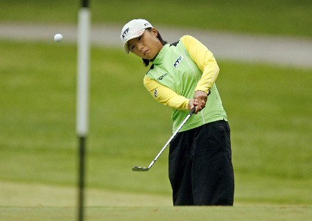 CLIFTON, NJ - MAY 18:   Mi Hyun Kim of South Korea chips onto the 17th green during the second round of the LPGA Sybase Classic at Upper Montclair Country Club on May 18, 2007 in Clifton, New Jersey.  (Photo by Hunter Martin/Getty Images)