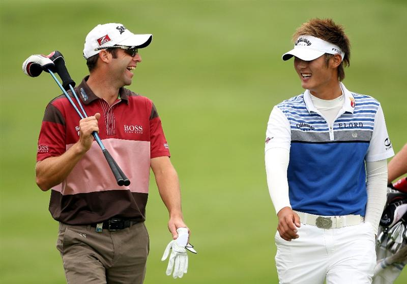 CRANS, SWITZERLAND - SEPTEMBER 03:  Bradley Dredge of Wales (left) shares a joke with Danny Lee of New Zealand on the 12th hole during the first round of The Omega European Masters at Crans-Sur-Sierre Golf Club on September 3, 2009 in Crans Montana, Switzerland.  (Photo by Andrew Redington/Getty Images)
