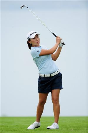 EVIAN-LES-BAINS, FRANCE - JULY 23:  In-Kyung Kim of Korea plays her approach shot on the fifth hole during the first round of the Evian Masters at the Evian Masters Golf Club on July 23, 2009 in Evian-les-Bains, France.  (Photo by Stuart Franklin/Getty Images)