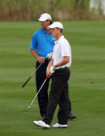 CHAMPIONS GATE, FL - DECEMBER 06: Paul Azinger of the USA with his partner Aaron Stewart the son of the late Payne Stewart on the 1st fairway during the first round of the Del Webb Father Son Challenge on the International Course at Champions Gate Golf Club on December 6, 2008 in Champions Gate, Florida.  (Photo by David Cannon/Getty Images)