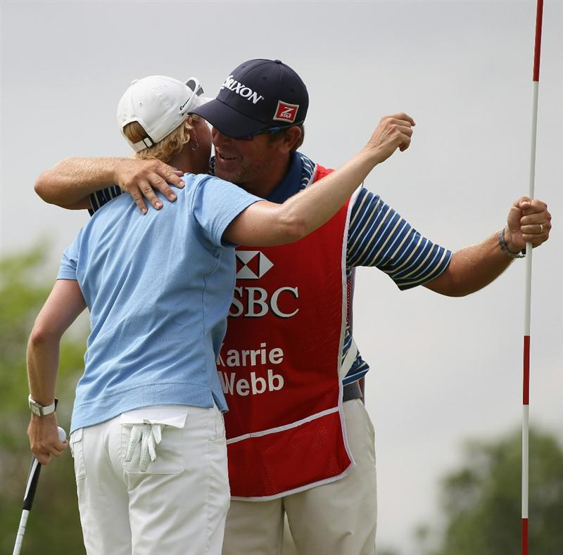 SINGAPORE - FEBRUARY 27:  Karrie Webb of Australia celebrates her win with her caddie during the final round of the HSBC Women's Champions at Tanah Merah Country Club  on February 27, 2011 in Singapore, Singapore.  (Photo by Ross Kinnaird/Getty Images)