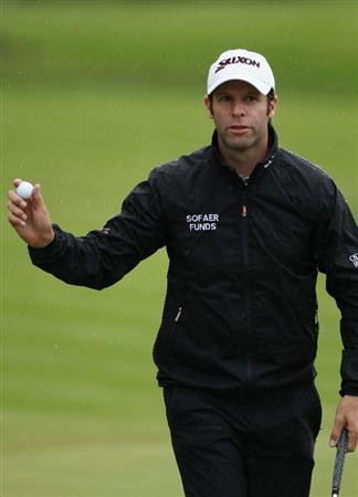 VIRGINIA WATER, ENGLAND - MAY 26:  Bradley Dredge of Wales acknowledges the crowd on the 18th green uring the first round of the BMW PGA Championship at Wentworth Club on May 26, 2011 in Virginia Water, England.  (Photo by Warren Little/Getty Images)