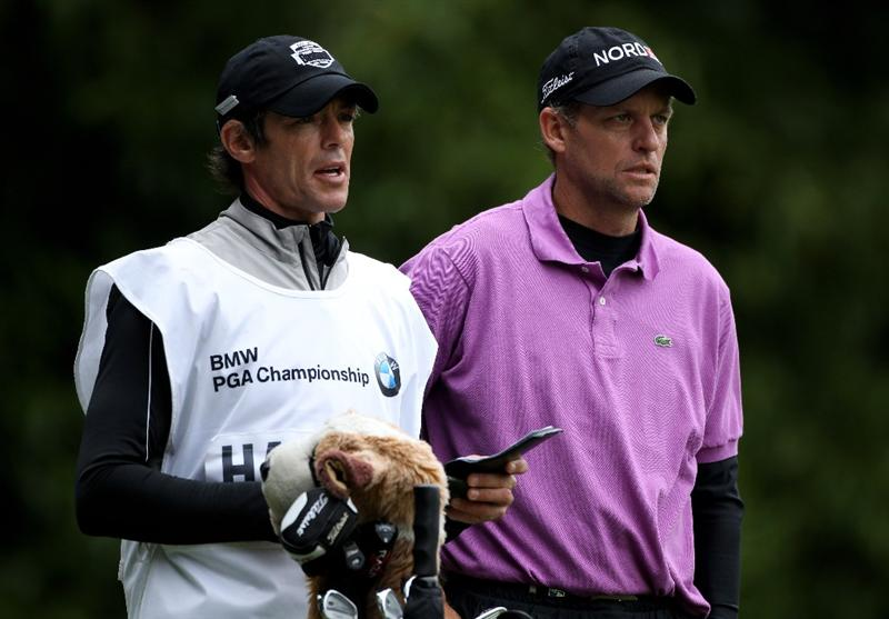 VIRGINIA WATER, ENGLAND - MAY 28:  Anders Hansen of Denmark waits with his caddie on the 2nd hole during the third round of the BMW PGA Championship at the Wentworth Club on May 28, 2011 in Virginia Water, England.  (Photo by Warren Little/Getty Images)