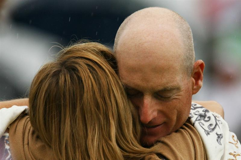 ATLANTA - SEPTEMBER 26:  Jim Furyk (R) hugs his wife Tabitha (L) in celebration of winning the FedExCup and THE TOUR Championship presented by Coca-Cola, the final event of the PGA TOUR Playoffs for the FedExCup, at East Lake Golf Club on September 26, 2010 in Atlanta, Georgia.  (Photo by Scott Halleran/Getty Images)