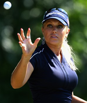 EVIAN, FRANCE - JULY 26:  Natalie Gulbis of USA catches a ball as she warms up on the driving range before teeing off in the third round of the Evian Masters at the Evian Masters Golf Club on July 26, 2008 in Evian, France.  (Photo by Andrew Redington/Getty Images)