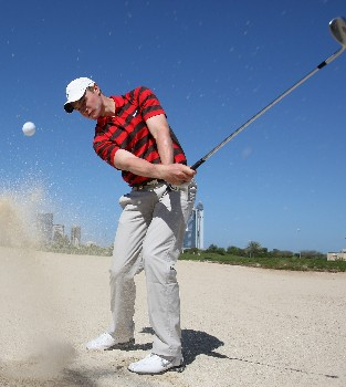 DUBAI, UNITED ARAB EMIRATES - JANUARY 29:  Oliver Fisher of England plays from a bunker during his practice session prior to the Dubai Desert Classic on the Majlis Course held at the Emirates Golf Club on January 29, 2008 in Dubai,United Arab Emirates.  (Photo by Ross Kinnaird/Getty Images)