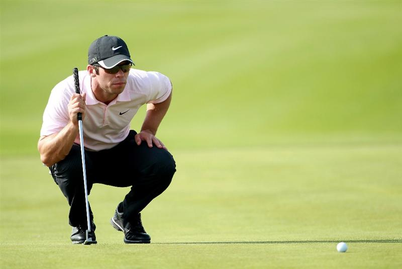 BAHRAIN, BAHRAIN - JANUARY 30:  Paul Casey of England lines up a putt during the final round of the Volvo Golf Champions at The Royal Golf Club on January 30, 2011 in Bahrain, Bahrain.  (Photo by Andrew Redington/Getty Images)