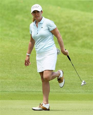 SINGAPORE - FEBRUARY 28:  Cristie Kerr of the USA reacts to a missed eagle putt on the 9th hole during the final round of the HSBC Women's Champions at Tanah Merah Country Club on February 28, 2010 in Singapore, Singapore.  (Photo by Andy Lyons/Getty Images)