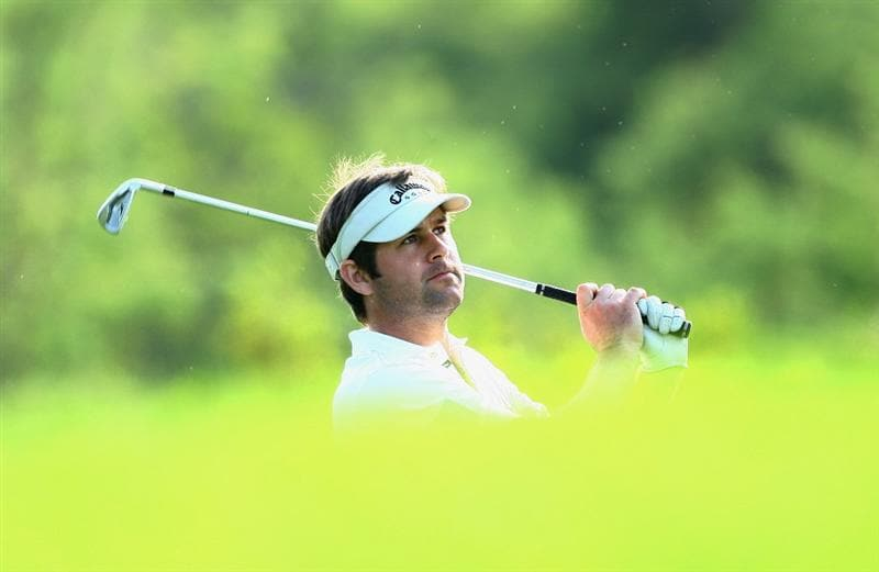NELSPRUIT, SOUTH AFRICA - DECEMBER 11:  Robert Rock of England plays his second shot into the 14th green during the first round of the Alfred Dunhill Championship at Leopard Creek Country Club on December 11, 2008 in Malelane, South Africa.  (Photo by Warren Little/Getty Images)