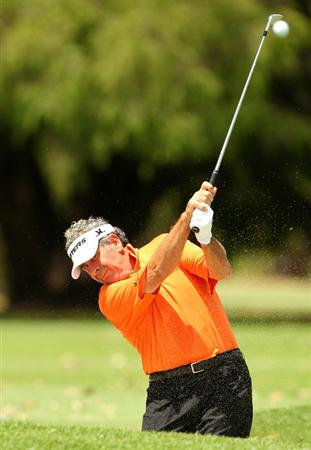 PERTH, AUSTRALIA - NOVEMBER 19:  Sam Torrance of Scotland plays a shot from the bunker on the 15th hole during day one the 2010 Australian Senior Open at Royal Perth Golf Club on November 19, 2010 in Perth, Australia.  (Photo by Paul Kane/Getty Images)