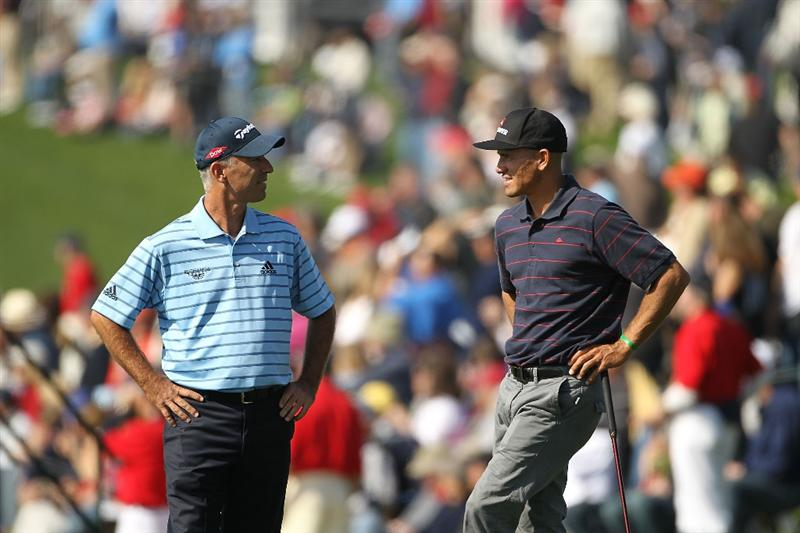 PEBBLE BEACH, CA - FEBRUARY 13:  Corey Pavin and Kelly Slater chat on the ninth hole  during round three of the AT&T Pebble Beach National Pro-Am at Pebble Beach Golf Links on February 13, 2010 in Pebble Beach, California.  (Photo by Ezra Shaw/Getty Images)