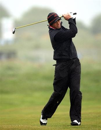 BALTRAY, IRELAND - MAY 16:  Nick Dougherty of England hits his second shot on the second hole during the third round of The 3 Irish Open at County Louth Golf Club on May 16, 2009 in Baltray, Ireland.  (Photo by Andrew Redington/Getty Images)