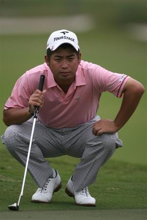 DORAL, FL - MARCH 12:  Yuta Ikeda of Japan lines up a putt on the first hole during round two of the 2010 WGC-CA Championship at the TPC Blue Monster at Doral on March 12, 2010 in Doral, Florida.  (Photo by Marc Serota/Getty Images)