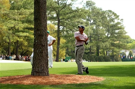 AUGUSTA, GA - APRIL 10:  Tiger Woods hits a shot from the rough on the first hole during the first round of the 2008 Masters Tournament at Augusta National Golf Club on April 10, 2008 in Augusta, Georgia.  (Photo by Andrew Redington/Getty Images)