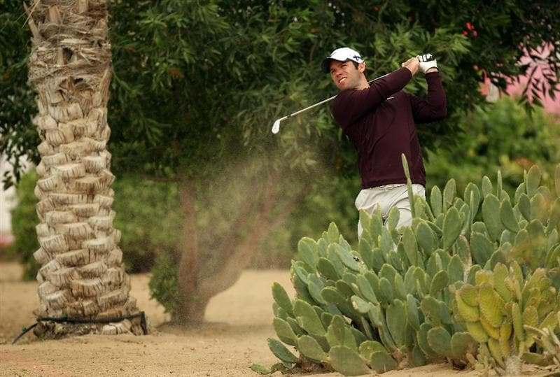 ABU DHABI, UNITED ARAB EMIRATES - JANUARY 19:  Paul Casey of England plays from the scrub on the par five second hole during the pro-am event prior to the Abu Dhabi HSBC Golf Championship at the Abu Dhabi Golf Club on January 19, 2011 in Abu Dhabi, United Arab Emirates.  (Photo by Ross Kinnaird/Getty Images)