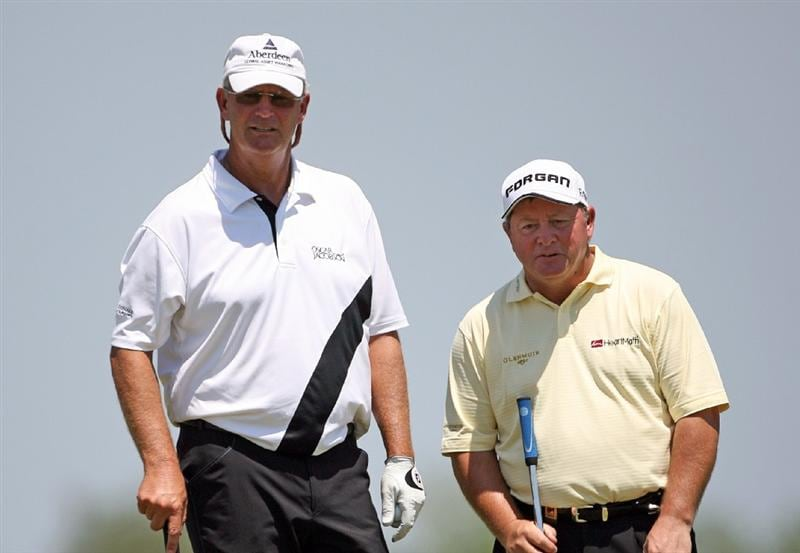 SAVANNAH, GA - APRIL 24:  (L-R) Sandy Lyle of Scotland and Ian Woosnam of Wales line up a birdie putt on the 18th green during the first round of the Liberty Mutual Legends of Golf at the Westin Savannah Harbor Golf Resort and Spa on April 24, 2009 in Savannah, Georgia. (Photo by Hunter Martin/Getty Images)