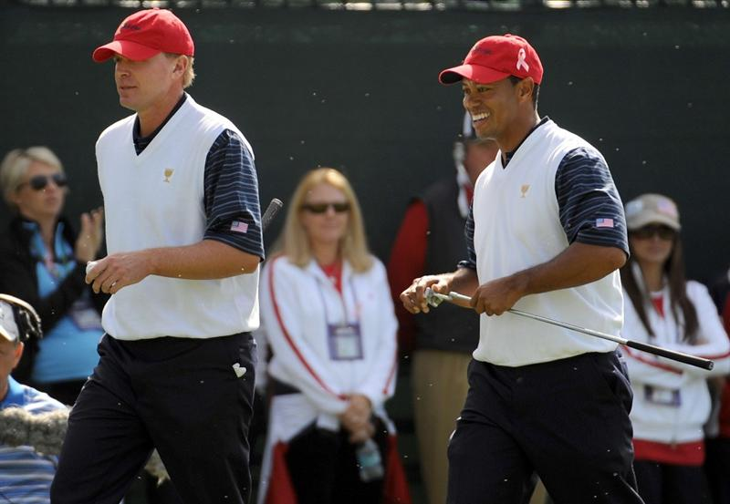 SAN FRANCISCO - OCTOBER 09:  Tiger Woods and Steve Stricker of the USA Team smile after winning the first hole during the Day Two Fourball Matches of The Presidents Cup at Harding Park Golf Course on October 9, 2009 in San Francisco, California.  (Photo by Harry How/Getty Images)