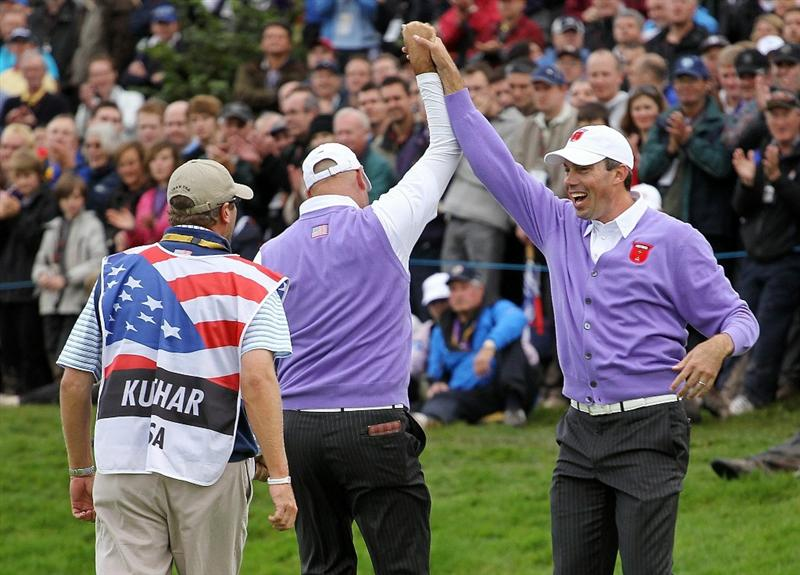 NEWPORT, WALES - OCTOBER 02:  Stewart Cink (C) of the USA celebrates his birdie putt on the 17th green with playing partner Matt Kuchar as caddie Lance Bennett looks on during the rescheduled Afternoon Foursome Matches during the 2010 Ryder Cup at the Celtic Manor Resort on October 2, 2010 in Newport, Wales.  (Photo by Andy Lyons/Getty Images)
