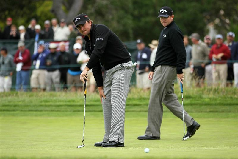 PEBBLE BEACH, CA - JUNE 18:  Graeme McDowell of Northern Ireland watches a putt miss as Shaun Micheel looks on during the second round of the 110th U.S. Open at Pebble Beach Golf Links on June 18, 2010 in Pebble Beach, California.  (Photo by Jeff Gross/Getty Images)
