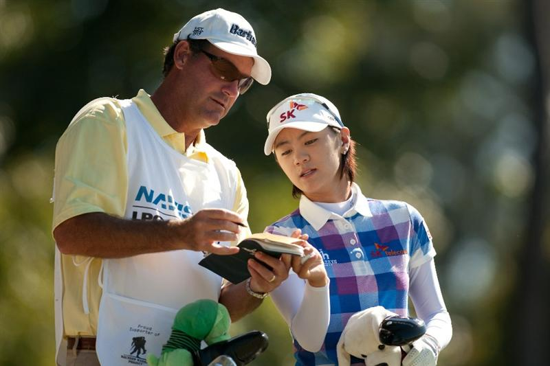 PRATTVILLE, AL - OCTOBER 7: Na Yeon Choi (R) of South Korea and caddie Paul Fusco discuss yardage on the 17th tee during the first round of the Navistar LPGA Classic at the Senator Course at the Robert Trent Jones Golf Trail at Capitol Hill on October 7, 2010 in Prattville, Alabama. (Photo by Darren Carroll/Getty Images)