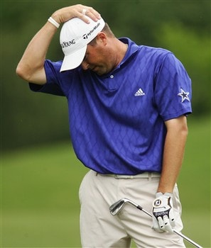 DULUTH, GA - MAY 18:   Ryan Palmer reacts after his second shot on the 13th hole during the final round of the AT&T Classic at TPC Sugarloaf on May 18, 2008 in Duluth, Georgia.  (Photo by Kyle Auclair/Getty Images)