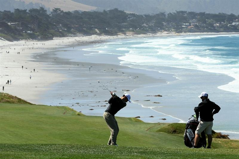 PEBBLE BEACH, CA - JUNE 16:  Rafael Cabrera-Bello of Spain hits a shot as his caddie looks on during a practice round prior to the start of the 110th U.S. Open at Pebble Beach Golf Links on June 16, 2010 in Pebble Beach, California.  (Photo by Jeff Gross/Getty Images)