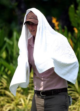 KUALA LUMPUR, MALAYSIA - MARCH 04:  Rhys Davies of Wales takes cover fron the sun during the first round of the Maybank Malaysia Open at the Kuala Lumpur Golf & Country on March 4, 2010 in Kuala Lumpur, Malaysia.  (Photo by Ross Kinnaird/Getty Images)