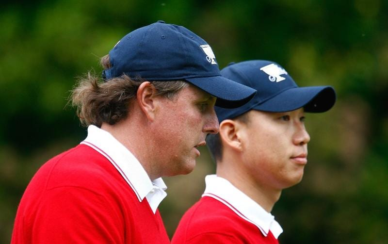 SAN FRANCISCO - OCTOBER 08:  Phil Mickelson and Anthony Kim of the USA Team walk down the first fairway during the Day One Foursome Matches of The Presidents Cup at Harding Park Golf Course on October 8, 2009 in San Francisco, California.  (Photo by Scott Halleran/Getty Images)
