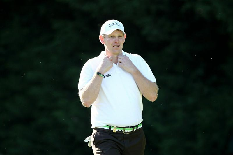 VIRGINIA WATER, ENGLAND - MAY 23:  Stephen Gallacher of Scotland walks up the 18th hole during the final round of the BMW PGA Championship on the West Course at Wentworth on May 23, 2010 in Virginia Water, England.  (Photo by Andrew Redington/Getty Images)