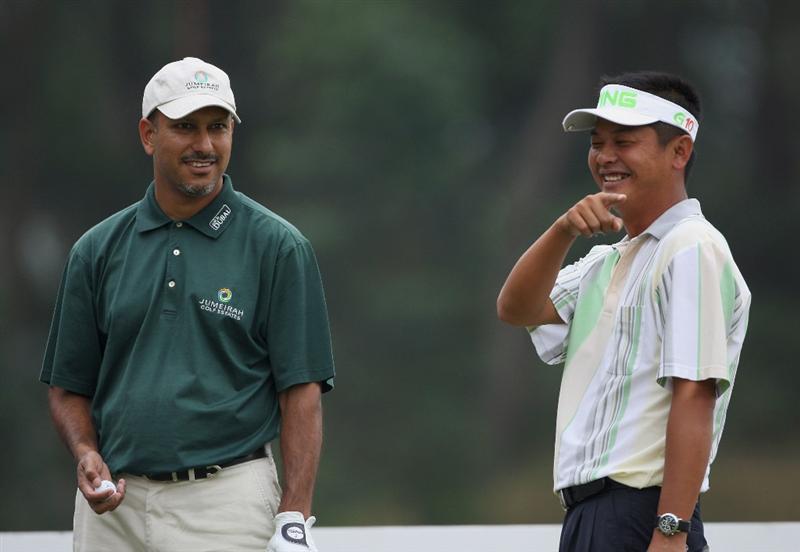 HONG KONG, CHINA - NOVEMBER 22:  Jeev Milkha Singh of India shares a joke with Wen Tang Lin of Tiapa on the 13th hole during the third round of the UBS Hong Kong Open at the Hong Kong Golf Club on November 22, 2008 in Fanling, Hong Kong.  (Photo by Stuart Franklin/Getty Images)