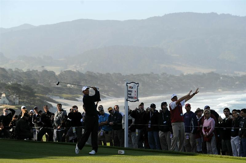 PEBBLE BEACH, CA - JUNE 16:  Tiger Woods watches a tee shot during a practice round prior to the start of the 110th U.S. Open at Pebble Beach Golf Links on June 16, 2010 in Pebble Beach, California.  (Photo by Harry How/Getty Images)