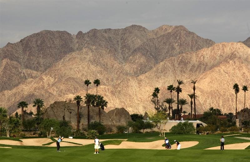 LA QUINTA, CA - JANUARY 23:  A group plays the 11th hole at the SilverRock Resort during the third round of the Bob Hope Chrysler Classic on January 23, 2009 in La Quinta, California.  (Photo by Stephen Dunn/Getty Images)