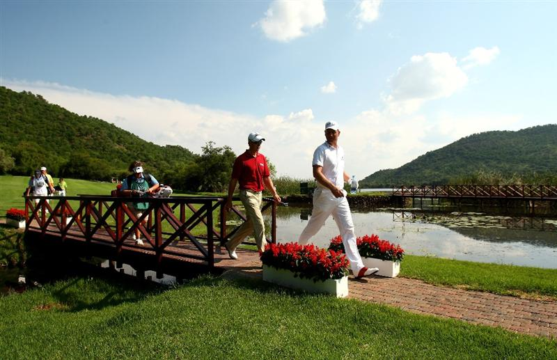 SUN CITY, SOUTH AFRICA - DECEMBER 07:  Robert Karlsson and Henrik Stenson of Sweden walk over a bridge to the 16th green during the final round of the Nedbank Golf Challenge at the Gary Player Country Club on December 7, 2008 in Sun City, South Africa.  (Photo by Richard Heathcote/Getty Images)
