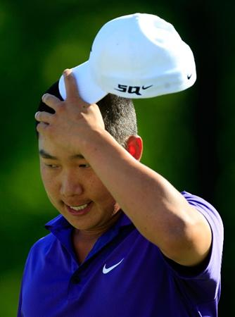 ST. LOUIS - SEPTEMBER 07:   Anthony Kim reacts after missing a putt on the 18th hole during the final round of the BMW Championship on September 7, 2008 at Bellerive Country Club in St. Louis, Missouri.  (Photo by Jamie Squire/Getty Images)