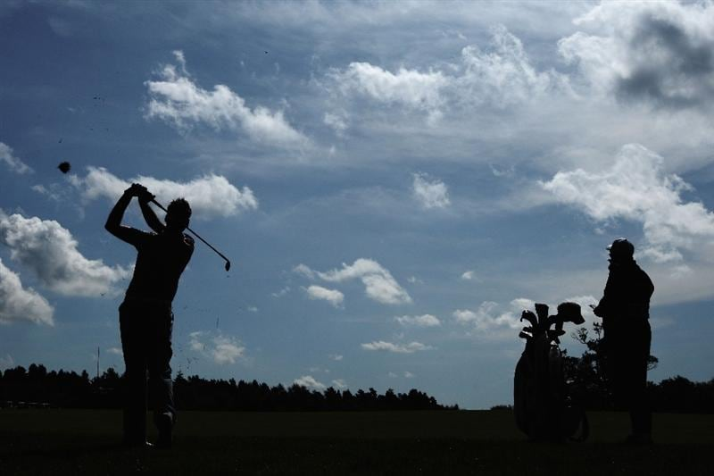 LUSS, SCOTLAND - JULY 11:  Ian Poulter of England hits his second shot on the 14th hole during the Third Round of The Barclays Scottish Open at Loch Lomond Golf Club on July 11, 2009 in Luss, Scotland.  (Photo by Andrew Redington/Getty Images)